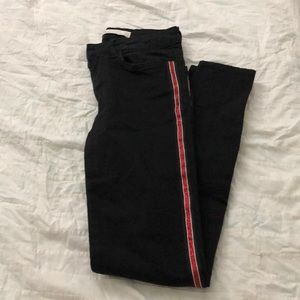 Love waisted black skinny jeans with red stripes
